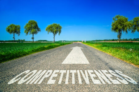 competitiveness: Conceptual Competitiveness word painted on asphalt road Stock Photo