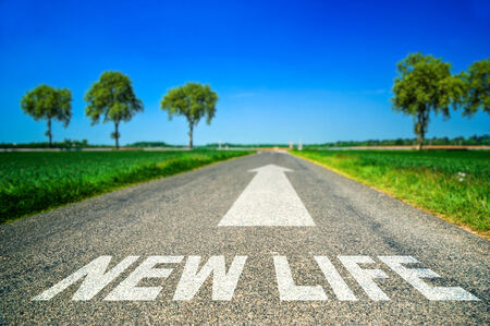 Conceptual New life word painted on asphalt road photo