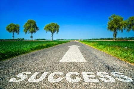 Conceptual Sucess word painted on asphalt road photo