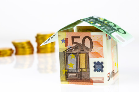 Real estate concept with Euro bank notes House and coins photo