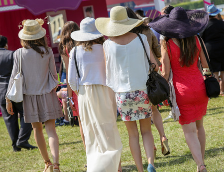 bourgeoisie: elegant women with their beautiful hats at the Prix de Diane, France