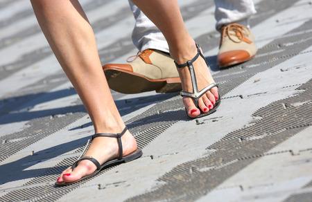 flipflops: closeup opposition about flip-flops and dress shoes