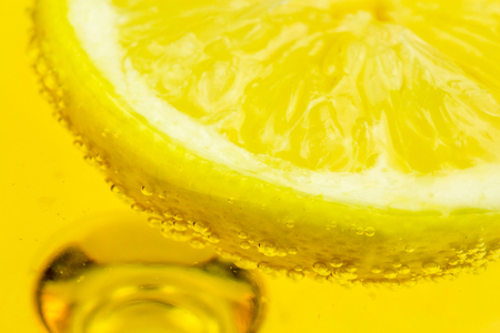 Closeup of Lemon on Alcohol glass photo