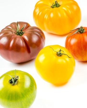 Closeup of varieties of colorful tomatos photo