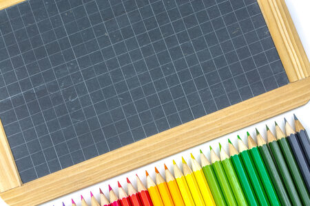 Closeup on colorful school supplies, pens and slate photo