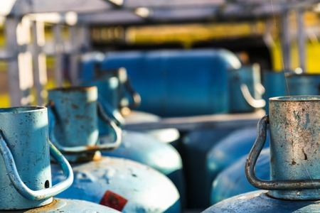 Closeup of stacks of gas cylinders on a distributor photo