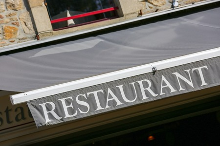 storefront of traditional french restaurant photo