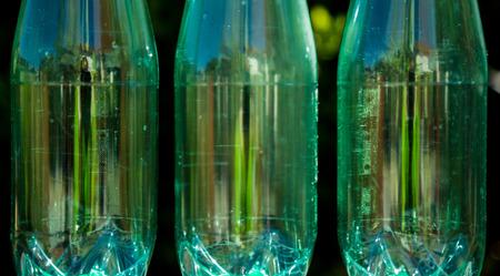Closeup of bottles isolated on nature background photo