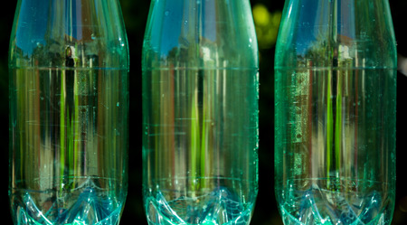 Closeup of bottles isolated on nature background photo