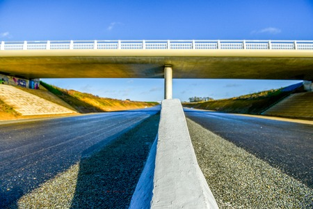 security barrier: A new highway with security barrier closeup under modern new bridge Stock Photo