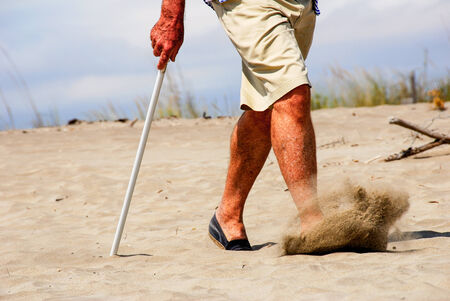 hardening: A man whos  taking a walk on the shore Stock Photo
