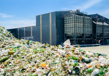 Heap of glass bottles near a recycling plant Éditoriale