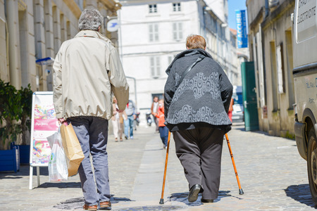 a picture of a disabled person walking with her friend photo