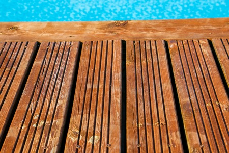close up on swimming pool with treated wood damaged photo