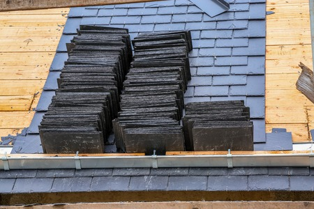 closeup on a roof in construction with slates