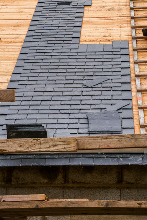 long lasting: closeup on a roof in construction with slates