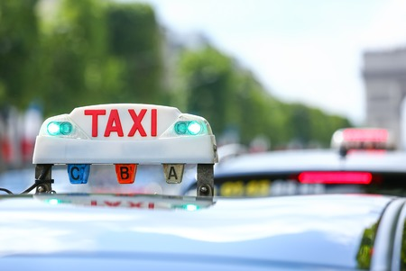 traditionally french: Parisian taxi in the city Stock Photo