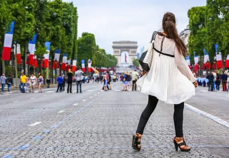 Very nice parisian girl in Paris on Champs Elysées avenue photo
