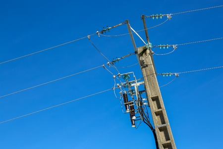 transforms: electric pole power lines and wires with blue sky