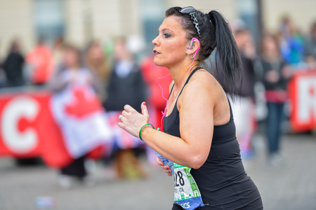 PARIS, FRANCE - APRIL 06: girl isolated at Paris International Marathon on April 06, 2014 in Paris, France Sajtókép