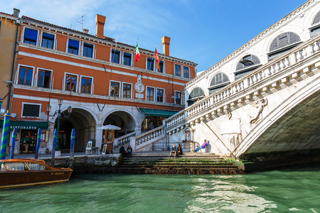 rialto bridge: VENICE, ITALY - MAR 18 - tourists near Rialto Bridge Canal Grande on Mars 18, 2015 in Venice, Italy. Editorial