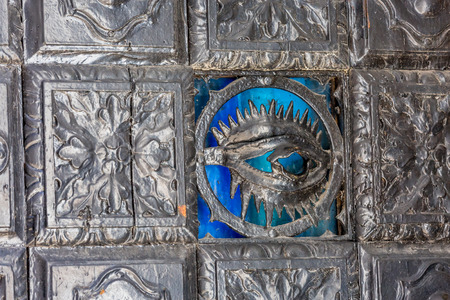 old wrought iron door with beautiful patterns photo