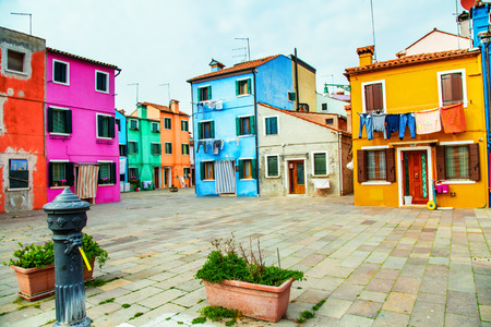 Colorful houses in Burano with the laundry drying on a wire