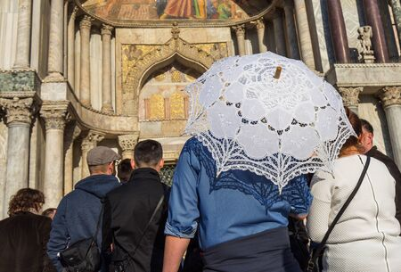guided: Group of tourists in front of the Basilica of San Marco