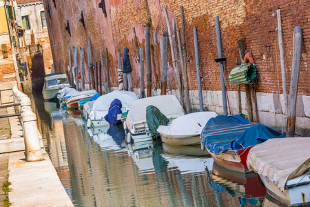 tarpaulin: Boats with tarpaulin in romantic narrow canal in Venice. Editorial