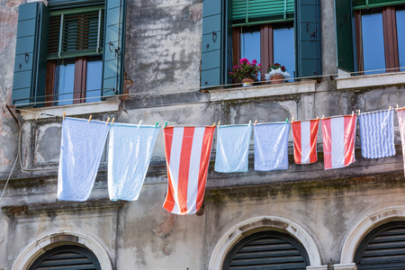 Venetian windows with the laundry drying on a wire photo