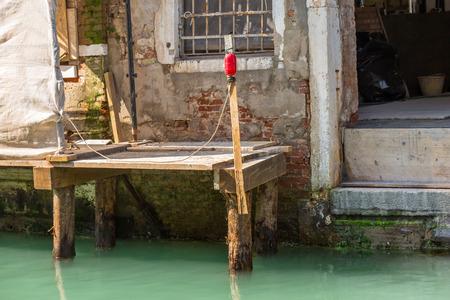 modernize: renovation of an old building on a narrow canal, venice