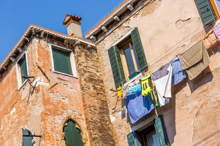 Beautiful Venetian house with the laundry drying on a wire photo