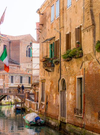 Romantic narrow canal in center of Venice.