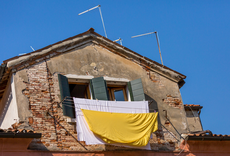 Venetian windows with the laundry drying on a wire