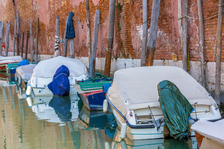 tarpaulin: Boats with tarpaulin in romantic narrow canal in Venice. Stock Photo