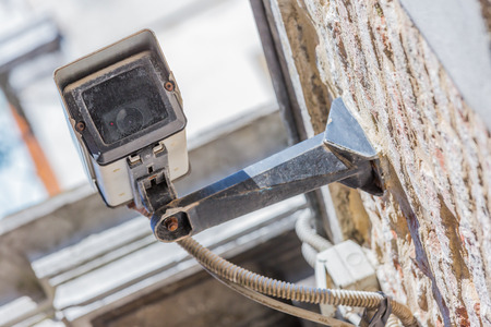 big brother spy: closeup view of modern security camera and urban video Stock Photo