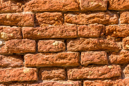 red stone wall texture grunge ans colored background photo