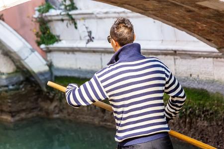 punting: Venetian gondolier punting gondola in Venice Italy