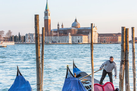 gondolier: VENICE, ITALY - MAR 18 - gondolier on Canal Grande on Mars 18, 2015 in Venice, Italy.