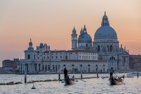 gondoliers: VENICE, ITALY - MAR 18 - Gondoliers at the end of work day on Canal Grande on Mars 18, 2015 in Venice, Italy. Editorial