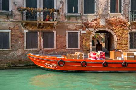 tnt: VENICE, ITALY - MAR 19 - TNT boat package delivery on Mars 19, 2015 in Venice, Italy. Editorial