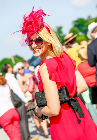 bourgeoisie: CHANTILLY - JUNE 15: Lovely smiling woman with a pretty hat at the Prix de Diane - The Prix de Diane horse race is a French qui runs Every year in June. In an atmosphere of sporting fervor and chic picnic Chantilly. Considered the price of elegance and di