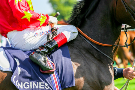 qui: CHANTILLY - JUNE 15: Close up of a jockey at the Prix de Diane - The Diana Award is a French horse race qui runs Every year in June. In an atmosphere of sporting fervor and chic picnic Chantilly. Considered the price of elegance and distinction, thanks to