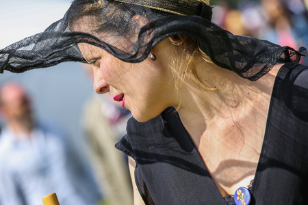 boater: CHANTILLY - JUNE 15: Lovely woman with a pretty hat at the Prix de Diane - The Diana Award is a French horse race qui runs Every year in June. In an atmosphere of sporting fervor and chic picnic Chantilly. Considered the price of elegance and distinction,