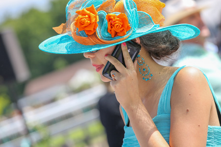 bourgeoisie: CHANTILLY - JUNE 15: Lovely woman with a pretty hat phoning - The Diana Award is a French horse race which runs Every year in June. In an atmosphere of sporting fervor and chic picnic Chantilly. Considered the price of elegance and distinction, thanks to