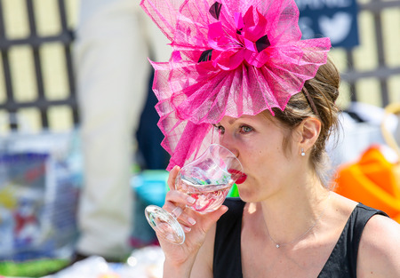 chantilly: CHANTILLY - JUNE 15: Beautiful and elegant woman drinking champagne at the Prix de Diane - The Prix de Diane horse race is a French who runs Every year in June. In an atmosphere of sporting fervor and chic picnic Chantilly. Considered the price of eleganc