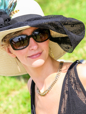 chantilly: CHANTILLY - JUNE 15: Lovely woman with a pretty hat at the Prix de Diane - The Diana Award is a French horse race which runs Every year in June. In an atmosphere of sporting fervor and chic picnic Chantilly. Considered the price of elegance and distinctio Editorial