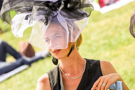 bourgeoisie: CHANTILLY - JUNE 15: Lovely mature woman with a pretty hat at the Prix de Diane - The Diana Award is a French horse race which runs Every year in June. In an atmosphere of sporting fervor and chic picnic Chantilly. Considered the price of elegance and dis