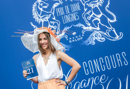 bourgeoisie: CHANTILLY - JUNE 15: Pretty candidate elegance of competition at the Prix de Diane - The Prix de Diane horse race is a French who runs Every year in June. In an atmosphere of sporting fervor and chic picnic Chantilly. Considered the price of elegance and  Editorial