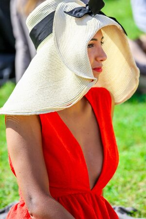 bourgeoisie: CHANTILLY - JUNE 15: Lovely woman with a pretty hat at the Prix de Diane - The Diana Award is a French horse race which runs Every year in June. In an atmosphere of sporting fervor and chic picnic Chantilly. Considered the price of elegance and distinctio Editorial